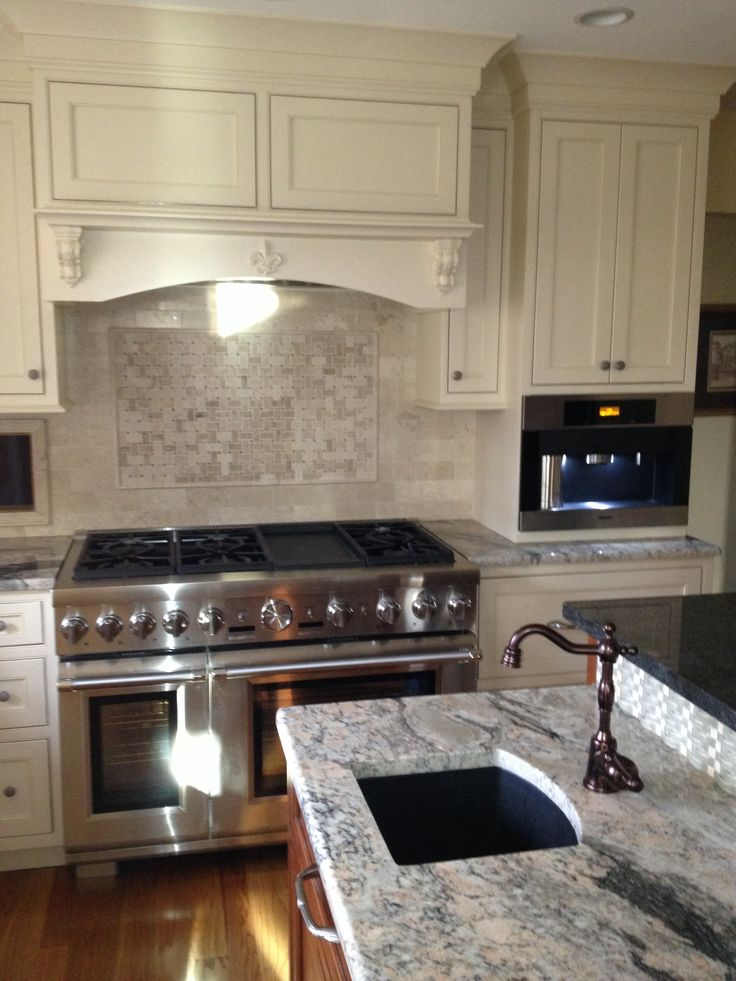 crema marfil marble backsplash thermador 8 burner