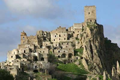 Ghost town Craco, Matera, Italy. In 1963 the remaining 1,800 inhabitants were transferred to a nearby valley called Craco Peschiera, and the original Craco remains in a state of crumbling decay to this day.