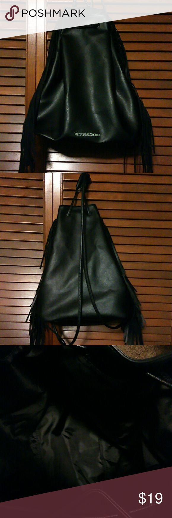 """Victoria's secret "" backpack Black , faux leather with fringe sides and an adjustable pull as a closure. Interior is an open space fully lined. L"