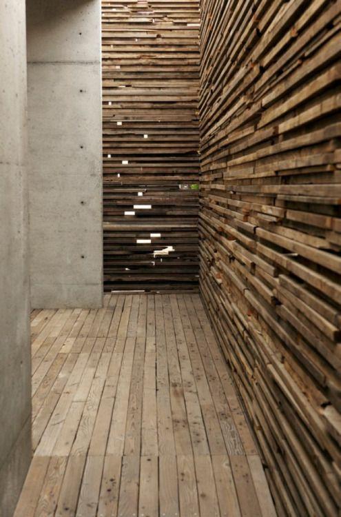 Wood Detailing in  in a entrance passageway   Learning Center / Sebastian Mariscal Studio 05   Lath wood walls