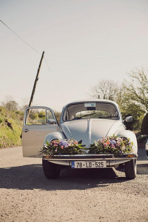 Love this - wedding car decorate with flowers on the bumper! From Rubistyle photography