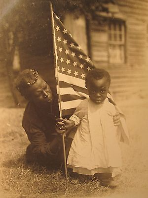 Vintage: African American woman and baby holding the American flag.