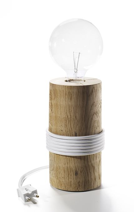 The Log Lamp, designed by Kevin Josias, has an oak pole, white or black cord and dimmer.