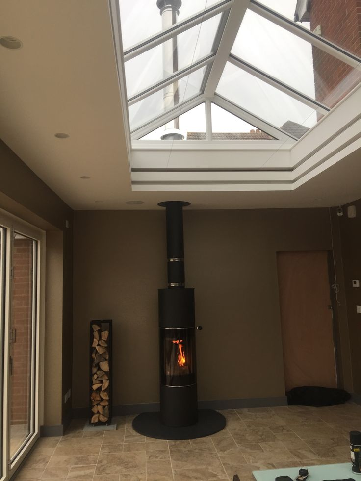 Rais Pilar & Woodwall with Poujoulat TI twin-wall flue-routing through fibreglass-roofed lantern - sprayed internally with our signature banding.