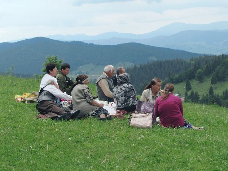 A Romanian family enjoys a picnic lunch in a meadow at Ciumarna Pass (1100 meters) between Moldovita and Sucevita monasteries.