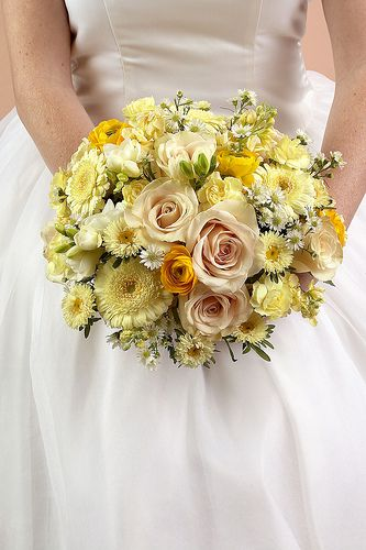 """#ChipotleWeddingSweepstakes  Nosegays are round clusters of flowers and a very trendy style of bridal bouquet. Also called a tussie mussie, this style of bouquet dates back to the 14th century, when it was used to mask unpleasant odors - thus the term """"nosegay."""" Nosegays can vary in sophistication and are therefore a good choice for any wedding.Flowers Featured: roses, gerberas, ranunculus, mini carnations, freesia, asters, monte casino—"""
