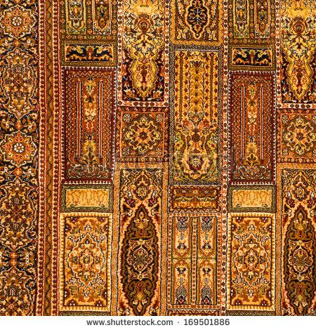 Beautiful ancient oriental colorful carpet with geometric motifs