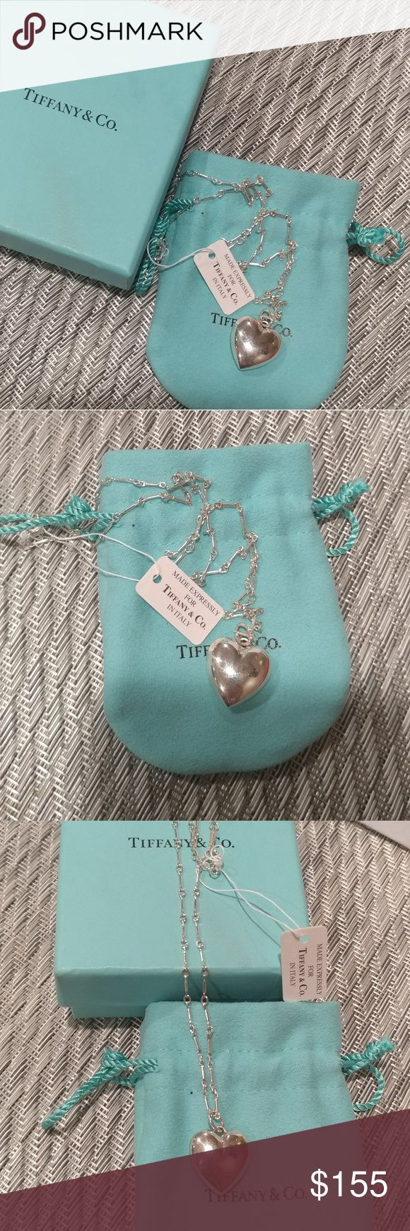 Tiffany & Co Sterling Silver Puffy Heart Necklace 100% Authentic NEW WITH TAGS Tiffany & Co AG 925 Italy Sterling Silver Puffy Heart Necklace. 18 in chain box and pouch included. Tiffany & Co. Jewelry Necklaces