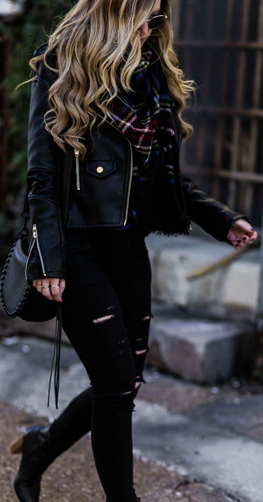 All black winter outfit styled with black leather jacket, black distressed jeans, plaid blanket scarf, and black ankle booties