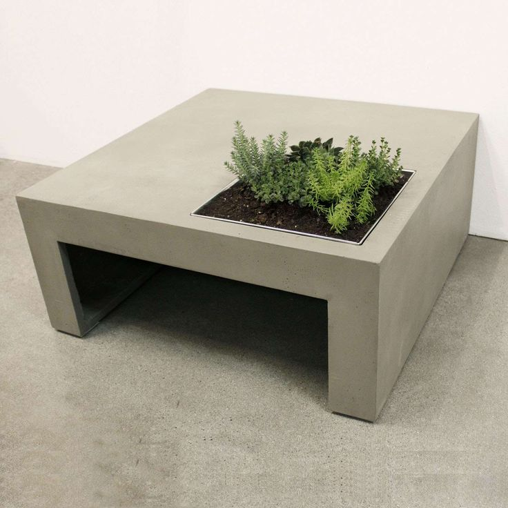 Concrete coffee table with planter