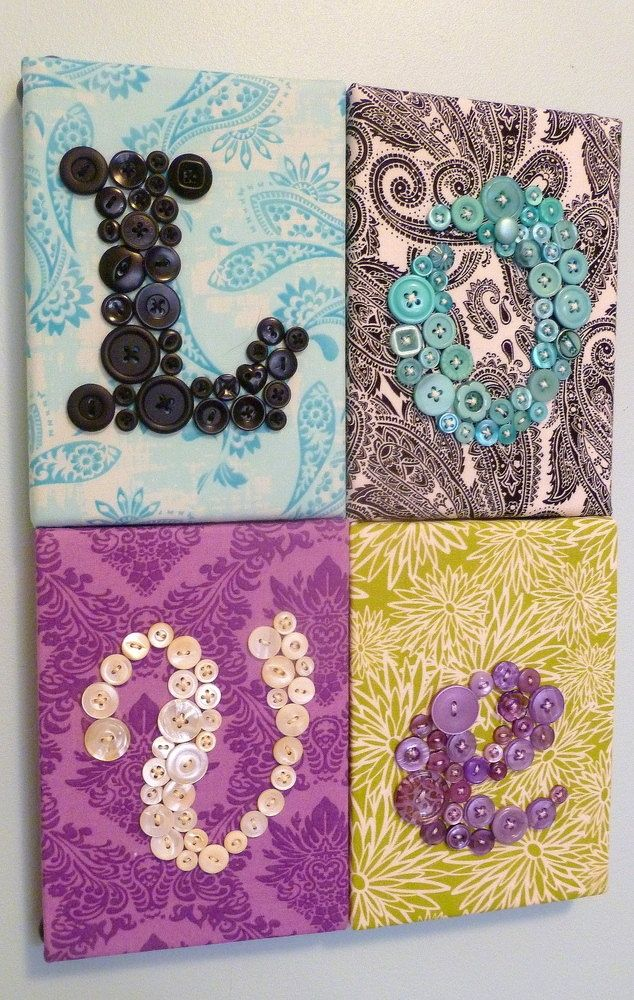 diy wall art...would be cute for various words/themes :) like how the colors vary but correspond between the buttons and material print.