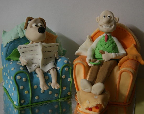 Wallace and Gromit cake all edible..The chairs are made from Orange maderia Cake and buttercream...Yum