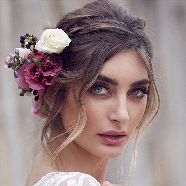 Dramatic hair flowers to match a dramatic look!