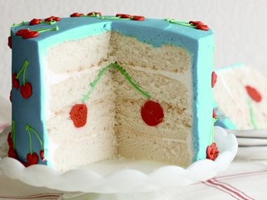 """""""Surprise-Inside Cakes"""". How-to book from Amanda Rettke. Pretty cherry design inside and out, with turquoise icing."""