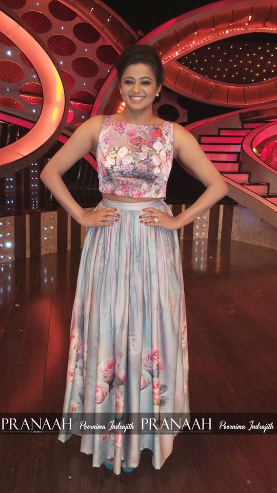Priyamani in grey coloured  floral skirt topped with pink coloured floral top.