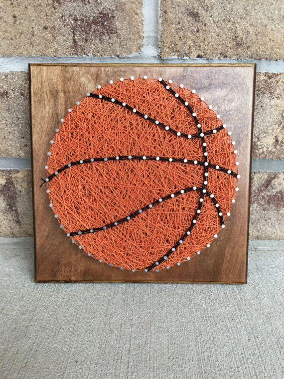 This is 9x9 basketball string art board.  The board will be made upon ordering so if you would like something different please let me know.  If you prefer something else besides a basketball like baseball, soccer ball, volleyball, football, tennis, softball and so on let me know can do almost any custom order.  The board will come with a sawtooth hanger attached.  Any questions please ask will try my best to get your order out within 2 weeks.
