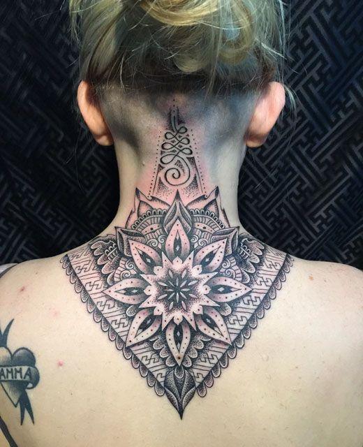 triangle-shape-cool-mandala-flower-tattoo-on-back #flowertattoosonback