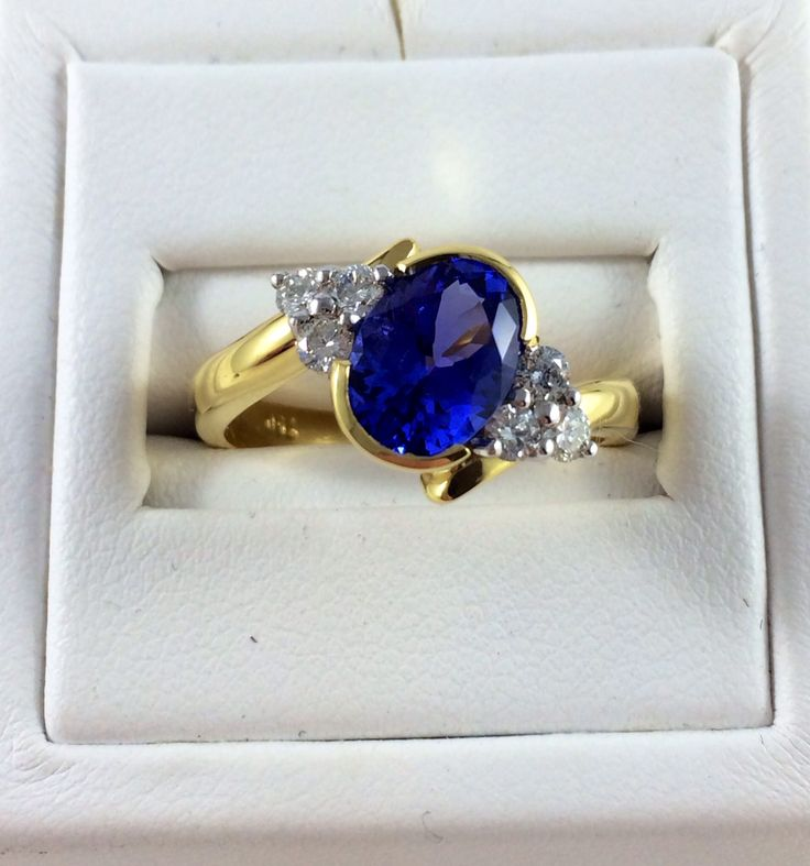 Individully Hand crafted by our in house jewellers, an 18ct Yellow and White Gold semi bezel set Oval Tanzanite stone with 6 claw set round brilliant cut diamonds. #tanzanite #blingring #phenixjewellery