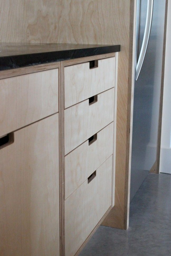 The Little Forest House, plywood kitchen cabinet cutouts | Remodelista