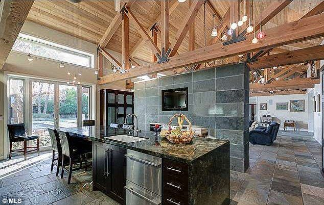 Megan Fox and Brian Austin Green have just scooped up scooped up a 6,710 square-foot four-bedroom, six-bathroom home in Toluca Lake, California. The sprawling property reveals a spacious open-plan design, with a gorgeous exposed wooden beam cathedral ceiling throughout the main living and kitchen areas http://dailym.ai/1wsbuLW