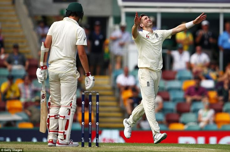 Chris Woakes celebrates after taking the wicket of Pat Cummins, who'd dug in to score 42 from 139 balls to frustrate England