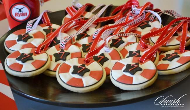 Everyone's a winner with these sugar cookie medals at this American Ninja Warrior-themed 7th birthday party.