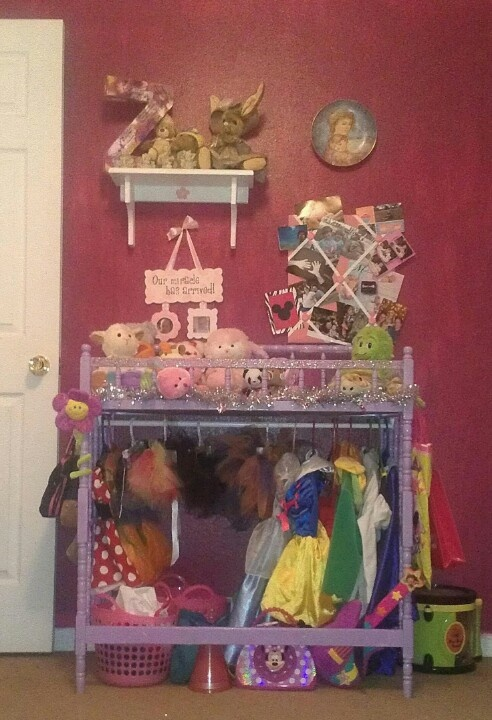 Ordinary changing table turned into dress up station. Take out middle shelf, I took.out both middle and bottom. Attach curtain rod underneath paint...and bonus spot for stuff animals.