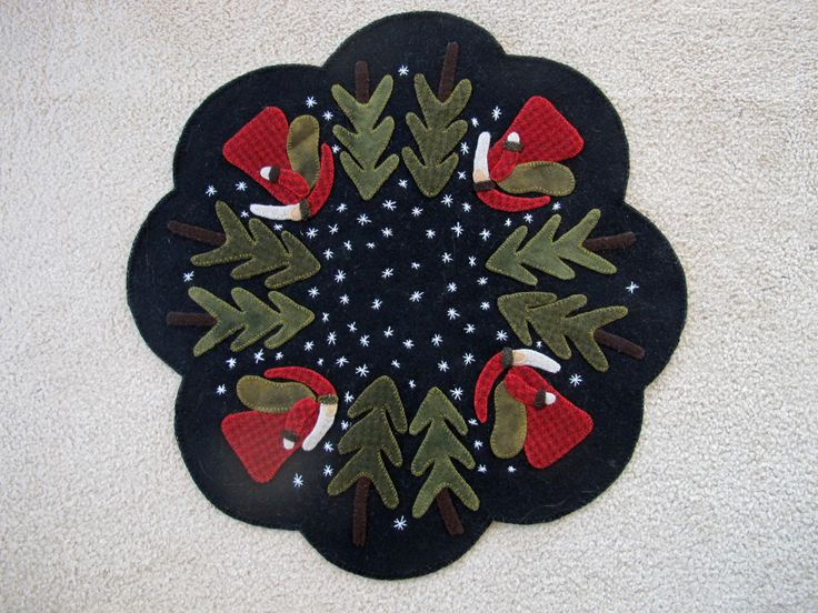 Santa table topper made by Janet Beyea.
