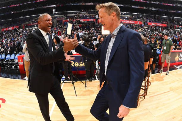 Steve Kerr of the Golden State Warriors and Doc Rivers of the LA Clippers shake hands before the game on October 30 2017 at STAPLES Center in Los...