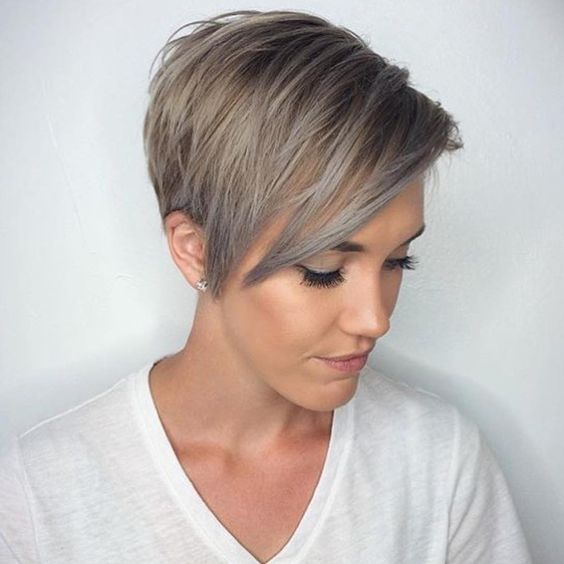 Cute, simple and easy to pull off, this neat pixie haircut is perfect for framing your feminine facial features. The cut is simple but cute and neat enough to pass off this look as classy with a touch of fun. Radiant coloring leaves the lengthy pixie cut with a beautiful gradient with darker roots and a lustrous golden body.  Read more: http://theperfecthairstyle.com/long-pixie-cuts/