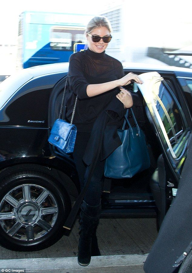 Taxi for Kate! Model Kate Upton arrived at LAX wearing a demure all-black ensemble