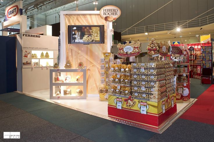 FERRERO @ WOOLWORTHS FAIR To promote the Ferrero christmas range of point of display units we created this eye catching display encapsulating the festive season  This is the third stand we built for Ferrero at successive Woolworths' conferences. Each year has seen a new design, maintaining Ferrero's contemporary edge