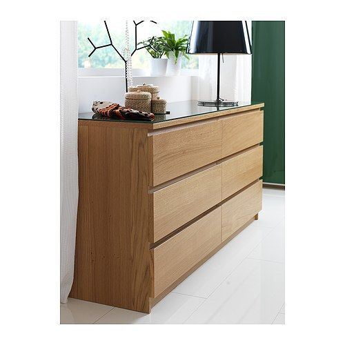 Good old Ikea... You can't really go wrong, can you!? This Malm chest of drawers for the bedroom, with a white glass top.