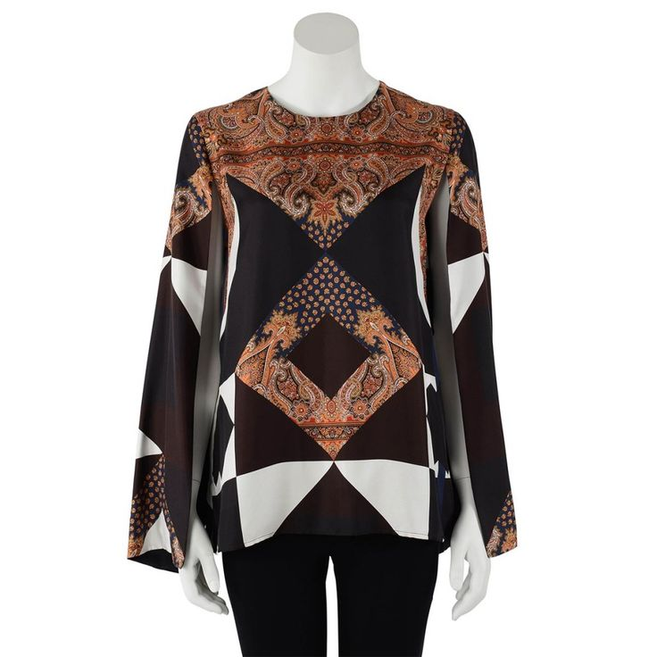 From Givenchy's Resort 2013 collection comes this paisley print patchwork silk top. A simple round neck style made chic with the addition of full slit long sleeves. An easy piece to work back with jeans ...