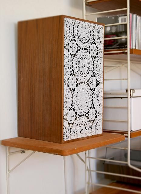 I'm looking for inexpensive lace table cloth with an interesting (non-old lady doily) to re-cover the stereo speakers from Dad.