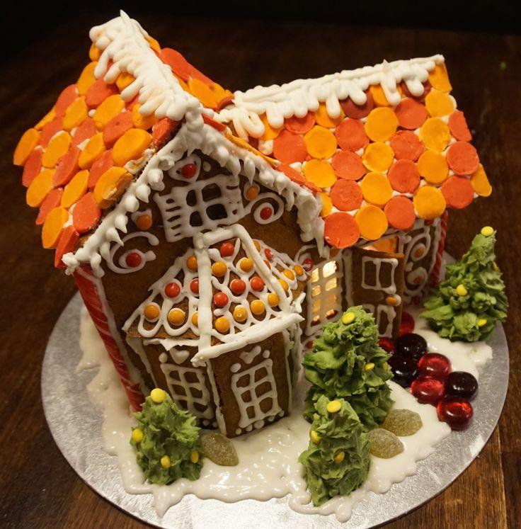 gingerbread house. red and orange. #whitespacesdesign http://www.whitespacesdesign.com