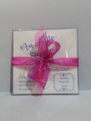 Transparent pocket folded card with ribbon.  Custom color and font to your specification.