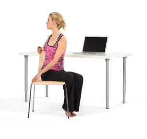 When you're feeling really tense, try a full-body stretch. Repeat each exercise for 5 breaths. Sit straight in a chair w/ both feet flat on the floor. Exhale as you round your spine forward then inhale as you arch your back. Next, inhale & extend your arms straight up. Stretch to the right as you exhale. Inhale as you come back to the center, then exhale to the left. Lastly, with arms bent at your side, exhale & rotate your torso to the right. Inhale back to center & twist to the left.
