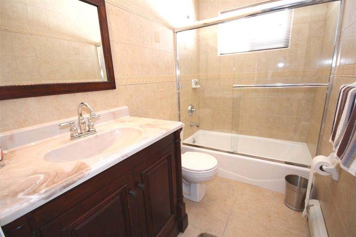 Craftsman 3/4 Bathroom with Flush, Raised panel, Complex Marble, frameless showerdoor, tiled wall showerbath, Undermount sink