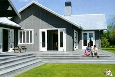 The original inspiration for wall cladding and colour and lighter roof colour is this house......Plywood and batten, stained with Resene Smokey Ash. or some other grey....Homestyle Magazine