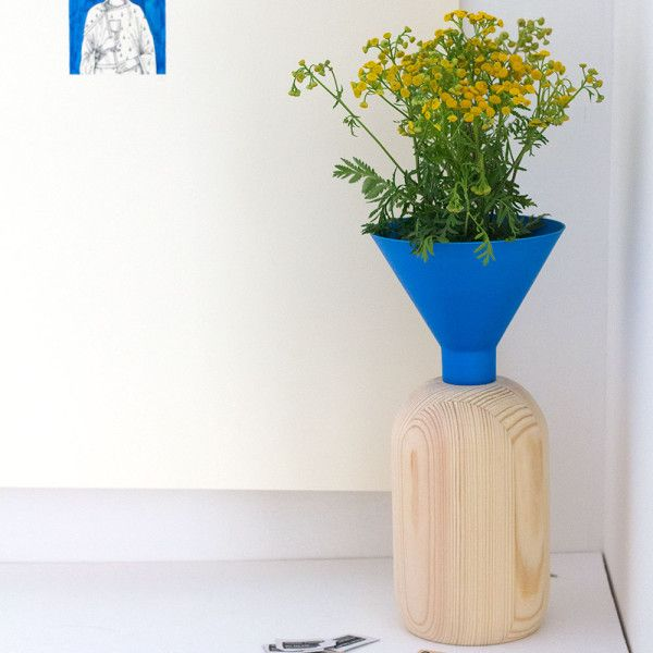This vase, available in a range of colours, by Romana Vyhnankova of Studio Muck caught my eye – I liked the pairing of bold colours with natural wood.