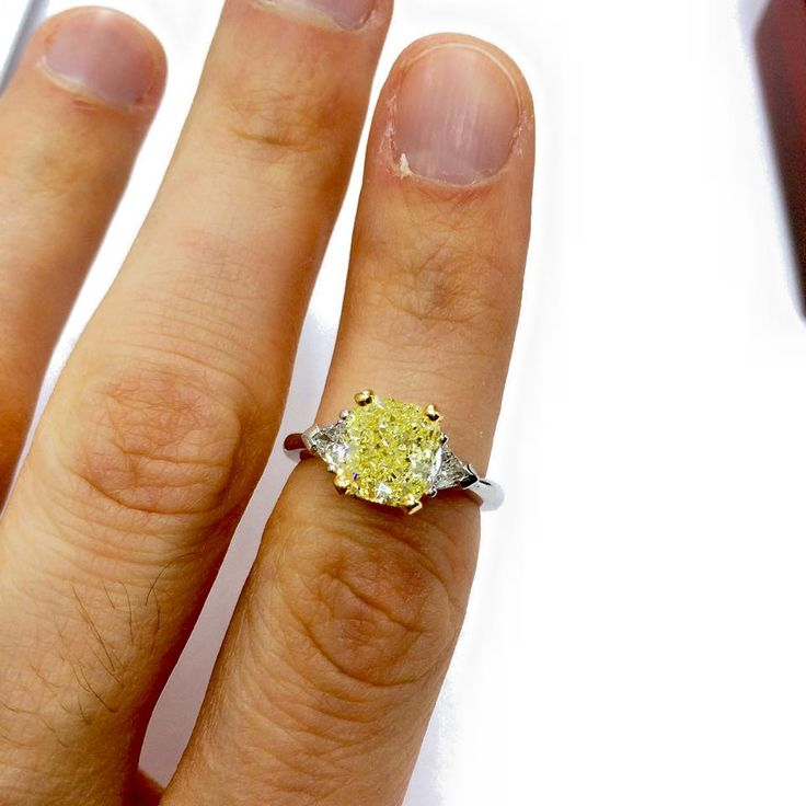 this rare 306 carat fancy yellow diamond with 2 triangle white diamond is available for - Wedding Rings Nyc
