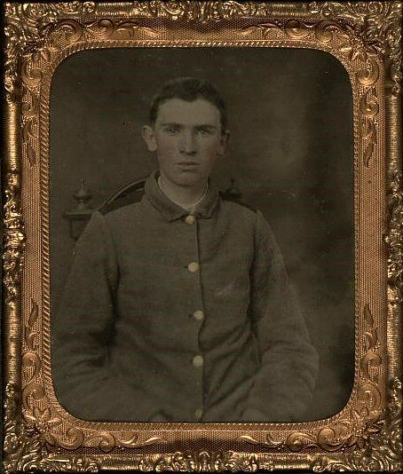 Private W.T. Harbison of Company B, 11th North Carolina Infantry Regiment  wearing the North Carolina sackcoat  with black strips on the shoulder and falling collar as specified in the above regulation.[Library of Congress]