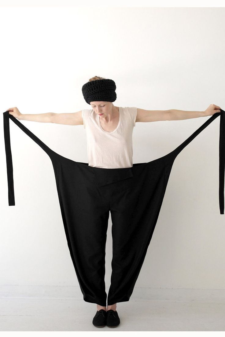 A unique and beautifully tailored tie pant in a black raw silk fabric.   Size small fits dress sizes 0-4/ Size medium fits dress sizes 4-8 /Large fits dress size 8-12 Roomy fit in leg with alarge pleat at ankle. Adjustable waist, fits most sizes.  Ties can be in front and covered by waist-flap, or tied at the hip. Fabric: 100% Raw Silk, dry clean only.