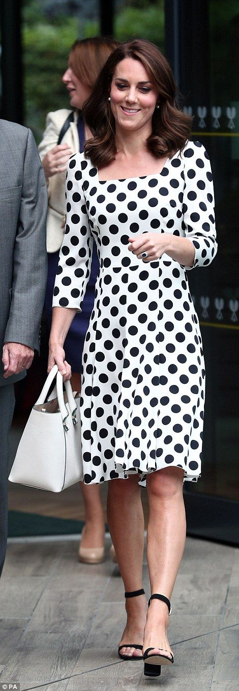 Kate eschewed her customary nude court shoes in favour of trendy black ankle strap sandals