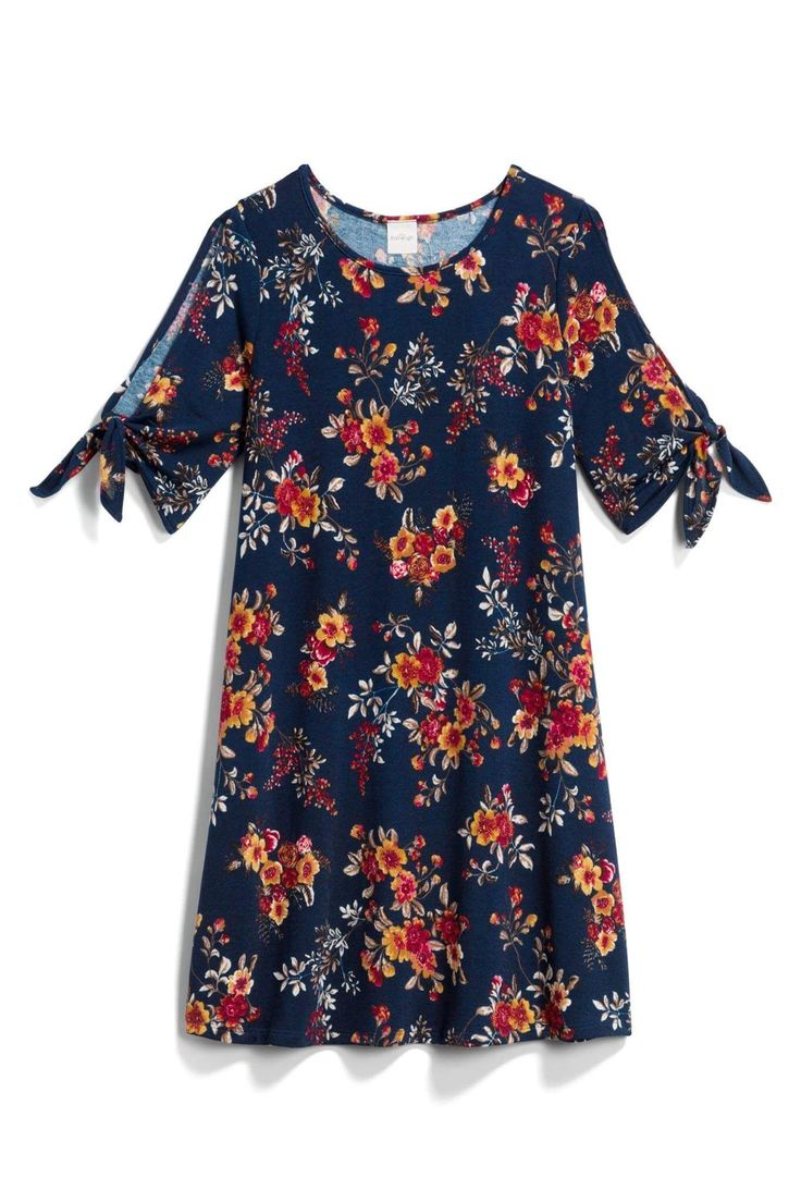 Stitch Fix clothes are JUST my style - like this gorgeous blue floral dress! Schedule your first fix today and see what your personal stylist will send to you! #affiliate