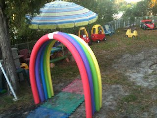 fun rainbow run through arch made from pool noodles!!  (planning to add more to make it longer)Pool Noodles, Pools Noodles, Rainbows Arches, For Kids, New Adventures, Parties, Cute Ideas, Outdoor Play, Fun