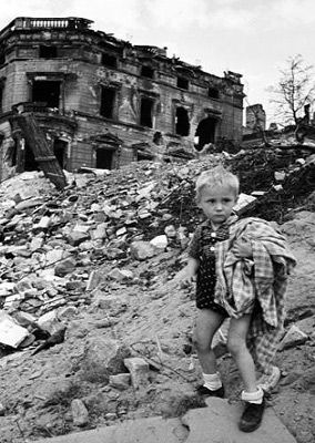 A German orphan among the debris of his home.  There were about 500,000 orphans at the end of the war.
