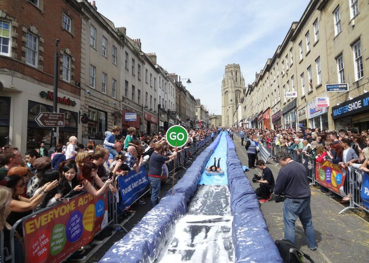 Luke Jerram transforms Bristol's Park Street into 90-metre water slide