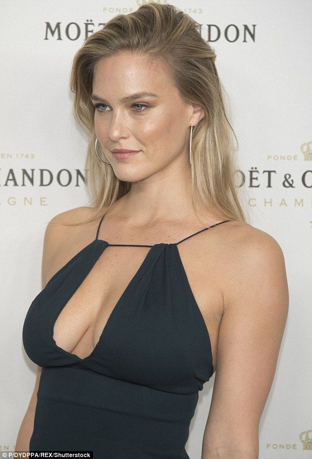 Eye-popping style: Slipping into a flesh-flashing black dress for Moet & Chandon's Christmas in November bash, the 31-year-old model ensured all eyes were on her